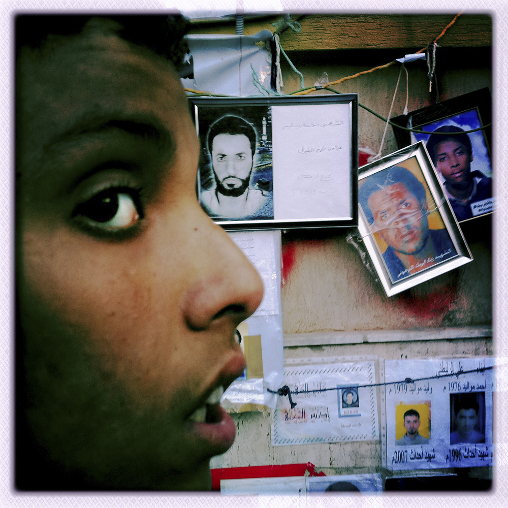Portraits of former prisoners and missing Libyan soldiers during the Libyan war with Chad, Benghazi, Libya, March 4, 2011.