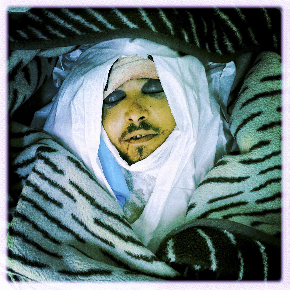 Dead opposition fighter on the floor of a hospital, Misratah, Libya, April 18, 2011.