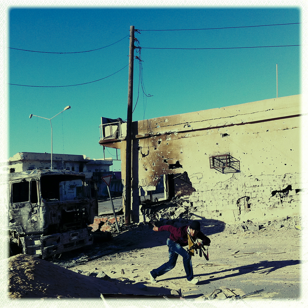 An opposition fighter, Ahmed, fighting snipers on Tripoli street, Misratah, Libya, April 18, 2011.