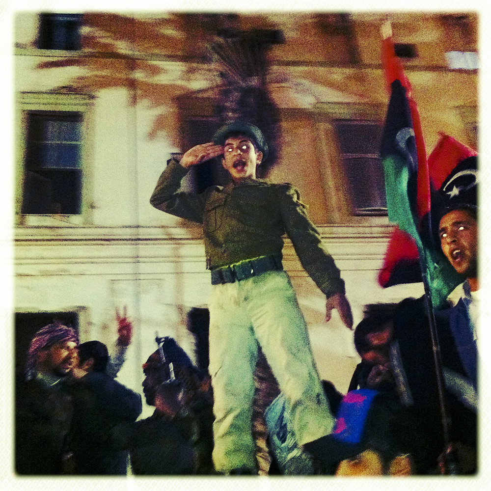 Opposition fighters celebrate a victory on the streets of Benghazi, Libya, March 16, 2011
