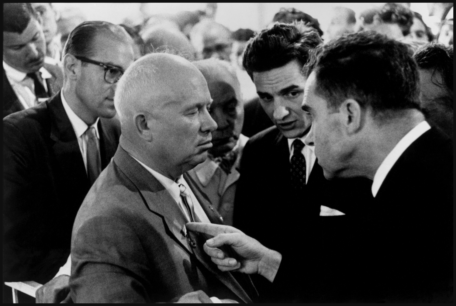 "Nixon and Khrushchev, Moscow, 1959. ""This is a picture that's quite well known. It's Nixon poking his finger into Khrushchev's vest. What can I say about it?  I was lucky to be there. Photography is essentially being in the right place at the right time and then crafting a good composition, then crafting everything that's around you so that it's easily readable. I was 31 and on assignment to take pictures of Westinghouse refrigerators, nothing to do with this photograph. But as it turned out, Nixon was in the Soviet Union on a state visit, so I simply attached myself to the press corps and got lucky."""