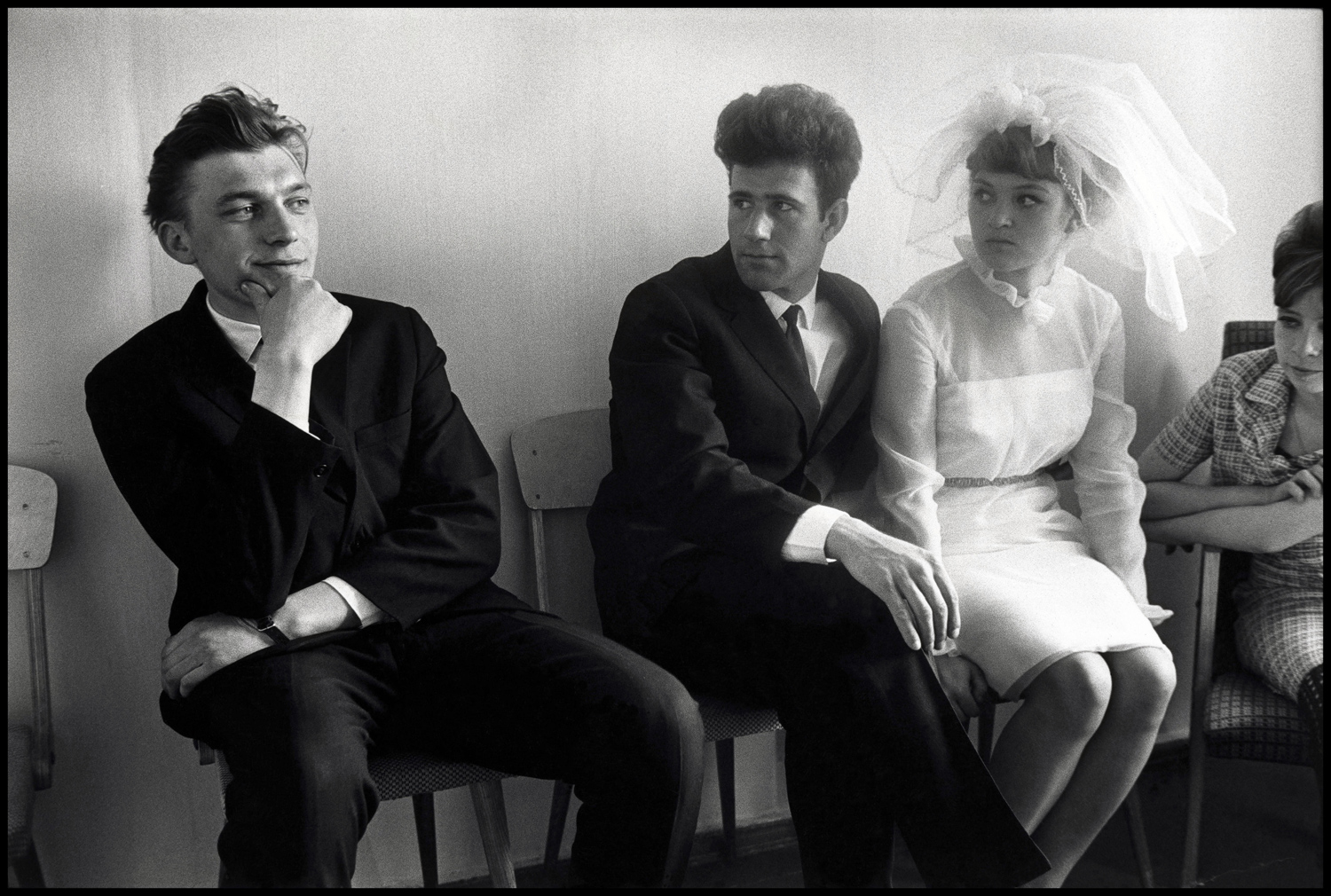 "Bratsk, Siberia, 1967. ""Here we have a picture that I'm quite fond of.  It was taken in Siberia at a wedding palace and shows a wedding couple and their best man. The best man seems to know something that the wedding couple are timid about. Anyway, it's a picture that's kind of funny...it makes you think. You can supply your own judgment about what is really on the mind of these people. I give this picture to friends of mine that are either getting married or divorced."""