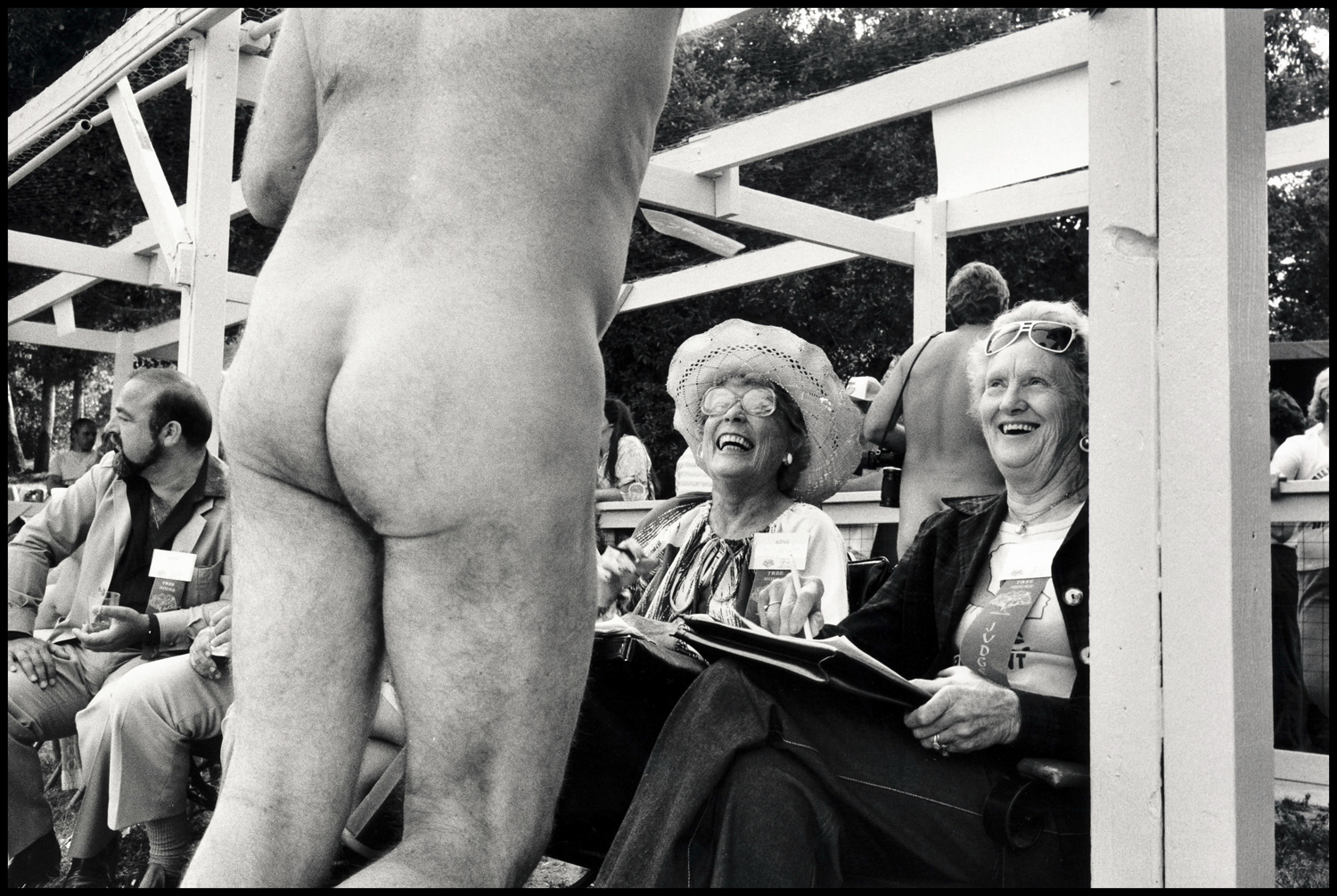 """This is a nudist in Bakersfield, California, 1953. It was made during a Mister Nudist pageant. This is one of the contestants trying to influence the judges. He lost."""