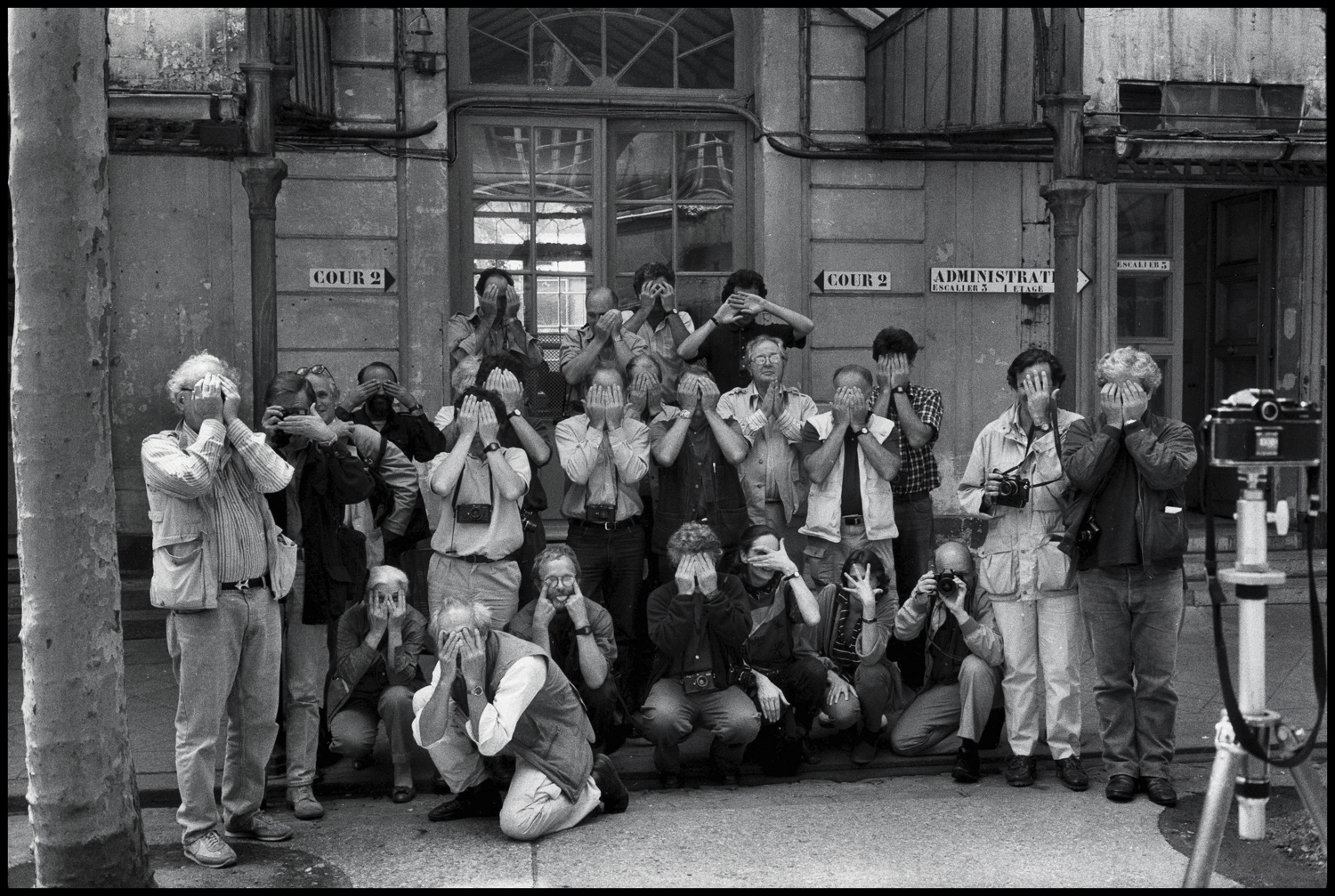 "Magnum photographers, Paris 1988. ""These are my Magnum colleagues. The reason they are all hiding their faces is because they weren't all there. I thought that if we all hid our faces, we wouldn't know who wasn't there, but it turned out to be kind of a funny picture — we know exactly who's there."""