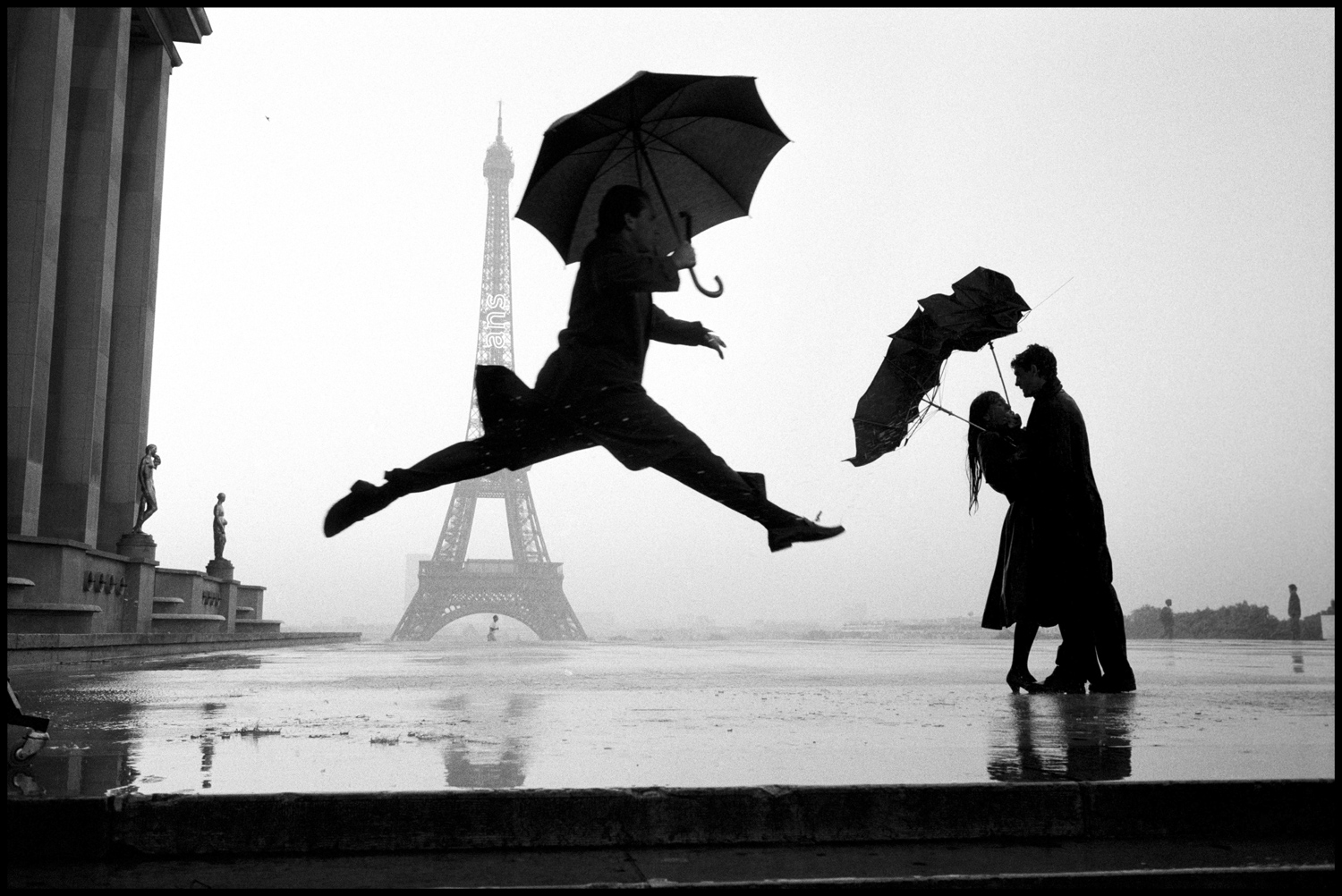 """This is turning out to be one of my better pictures.  It's a guy with an umberella jumping with the Eiffel Tower in the background. It's the cover of my recently published ""Paris"" book. This picture was taken about 15 years ago. I don't remember whether we had a rainstorm or if we created it. Was it for the Board of Tourism? Actually, you'd never have rain for [the Board of Tourism] unless it was in a rainforest."""