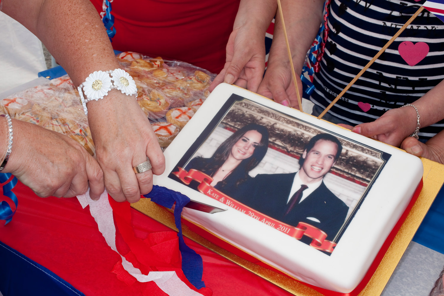 Cutting a cake celebrating the Royal wedding on Clare Road in Walsall, England.