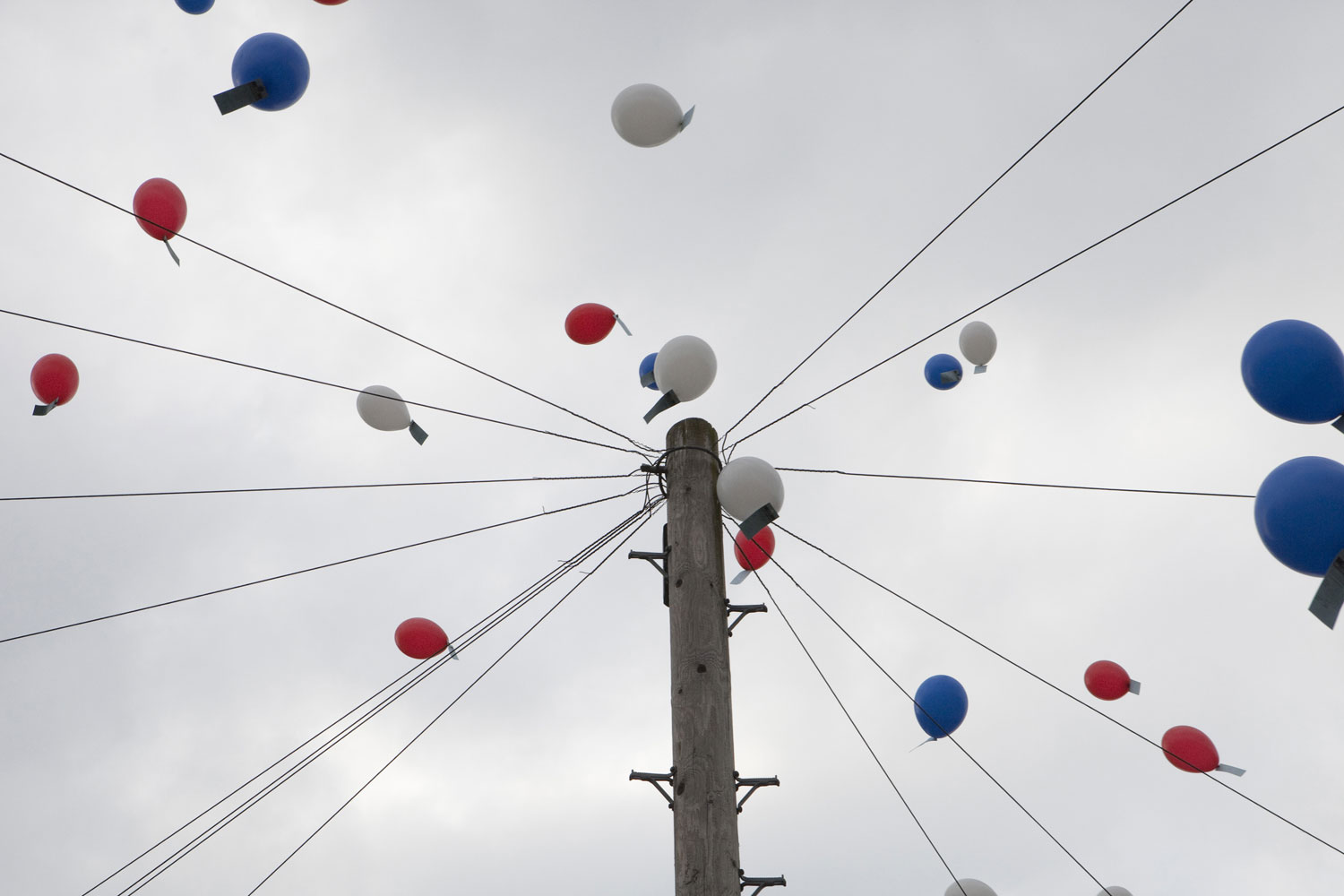 Red, white and blue balloons are raise into the sky at a Hobart Drive Street Party in Walsall, England.
