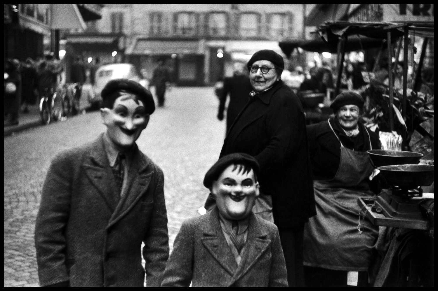 "In Erwitt's own words, reflections on his favorite photographs: ""This picture here of two kids with masks was taken in Paris in 1949. I was in the army at that time and and I was on furlough in Paris. Why is it a meaningful picture to me? It's meaningful because I think it's a good picture — no particular story in it. It's a snapshot. In fact, most of my good pictures are snaps."""