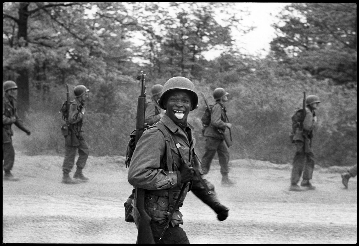 "Fort Dix, New Jersey, 1951. ""This picture of a soldier sticking his tongue at me was taken at Fort Dix during basic training.  I was in the Army as well walking next to him. I always carried my camera, a Leica with a collapsible lens, so it wouldn't be too bulky in my fatigues. It's a picture that I took then and I still like. An old picture…"""