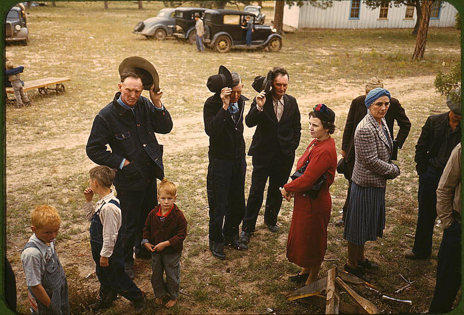 Russell Lee's photograph of men saying grace before a barbeque dinner at the New Mexico fair. Pie Town, New Mexico, October 1940, which Suau chose as an example of what inspires him about the work of the FSA photographers.  Oddly enough,  he says,  as primarily a black and white photographer, I chose a color photograph, first of all because I simply love this image but also as a sentimental tribute to my newly lost old friend, Kodachrome.