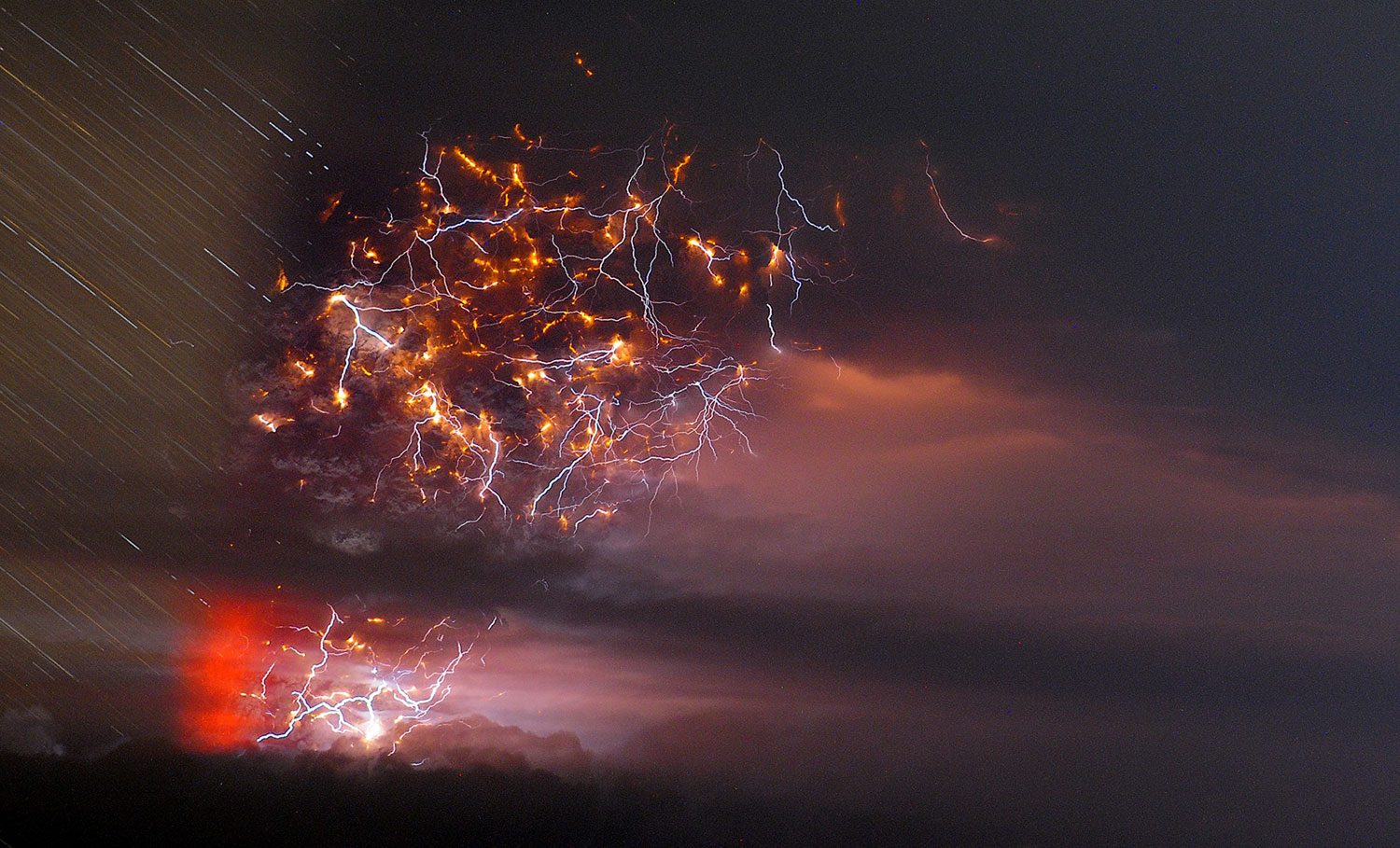 In this time-lapse photo, ash billows from Puyehue volcano as lightning strikes in southern Chile on June 5, 2011.
