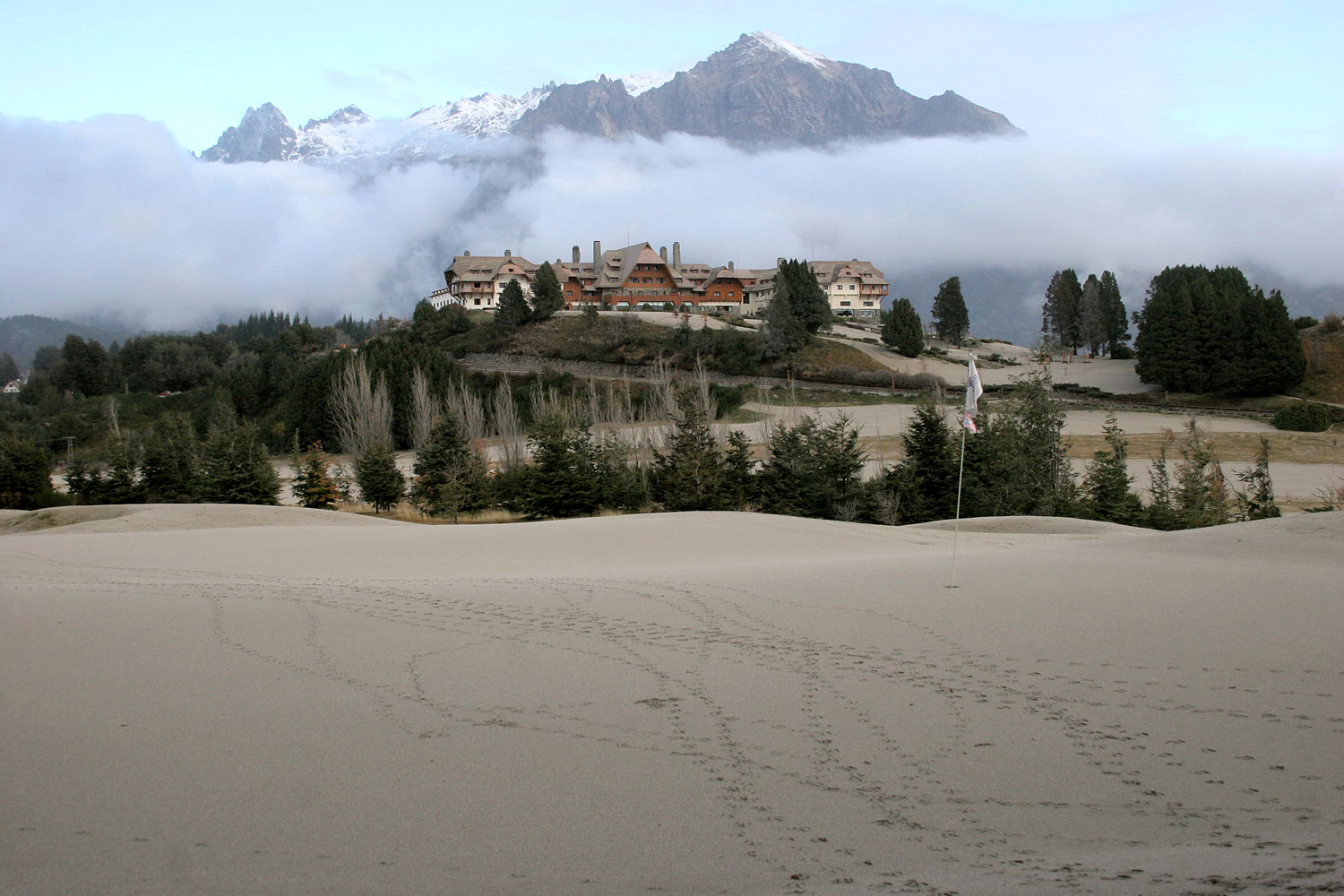 A view of the 9th hole green covered in ash at the Llao Llao hotel golf course in Bariloche, Argentina.