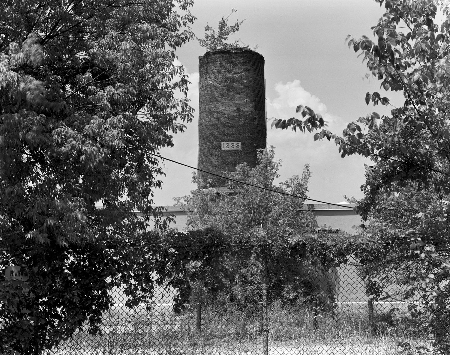 A view of a smokestack belonging to a now defunct General Electric plant, which was responsible for discharding enough PCB'sinto the bedrock of the Hudson to cause the EPA to declare a 200-mile stretch of the river a Superfund site. Hudson Falls, New York. 2010.