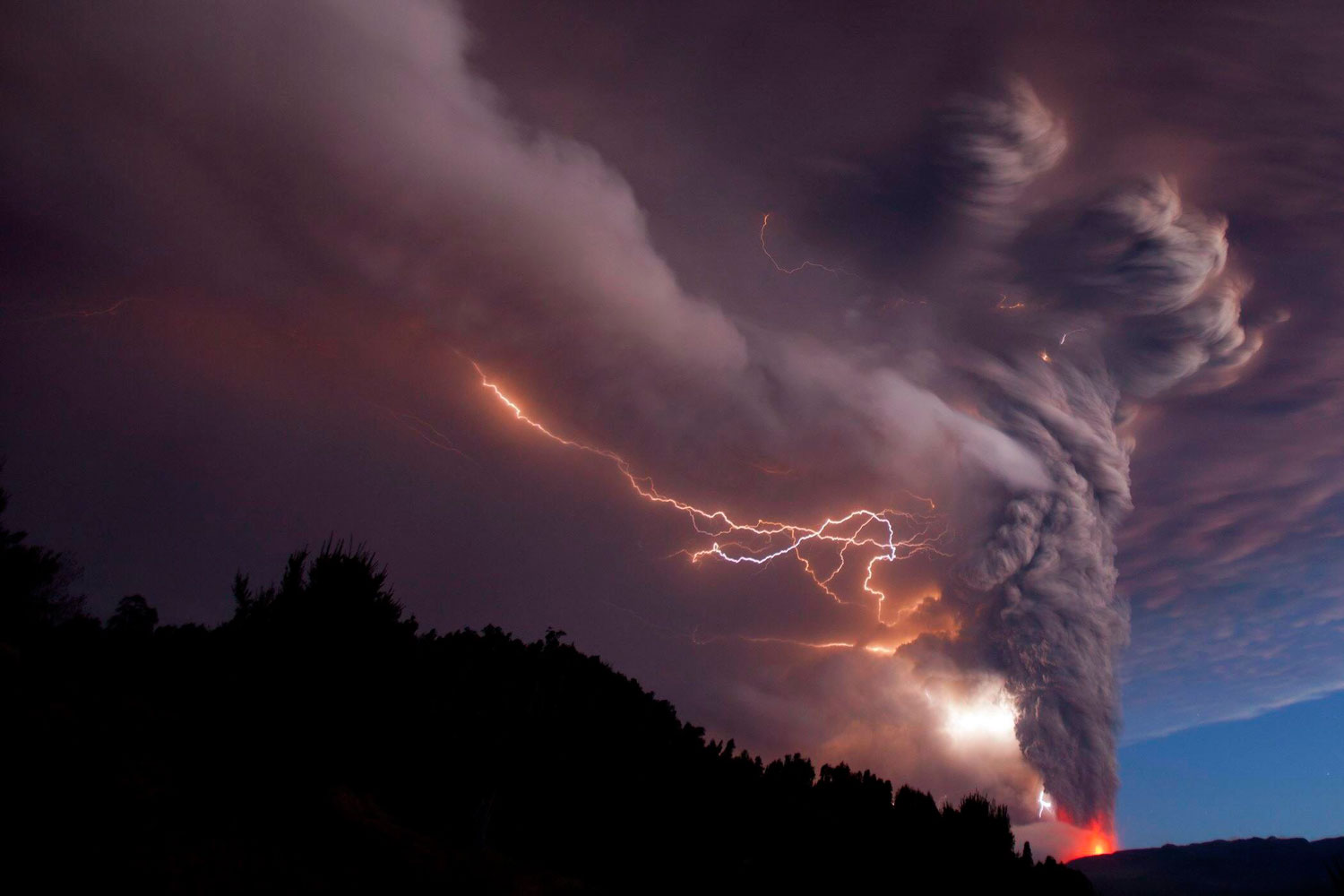 Smoke billowing into the sky after the eruption of the Puyehue volcano, June 05, 2011.