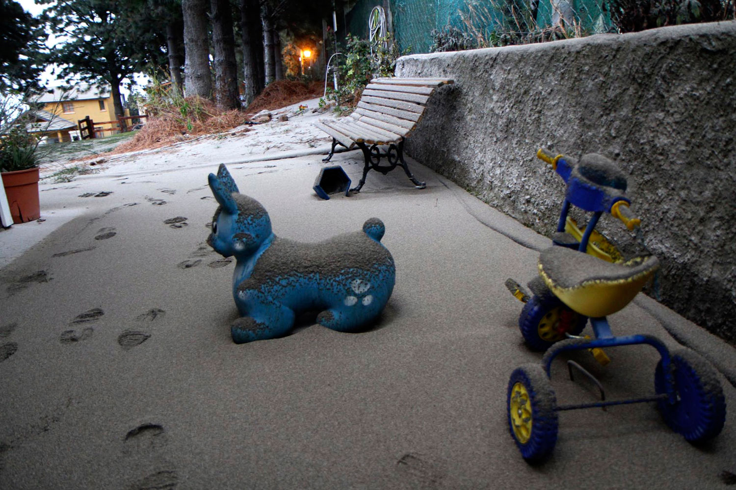 Toys covered with ash — from a volcano in the Puyehue-Cordon Caulle chain — over 100 miles away in the Argentine resort city of San Carlos de Bariloche June 5, 2011.