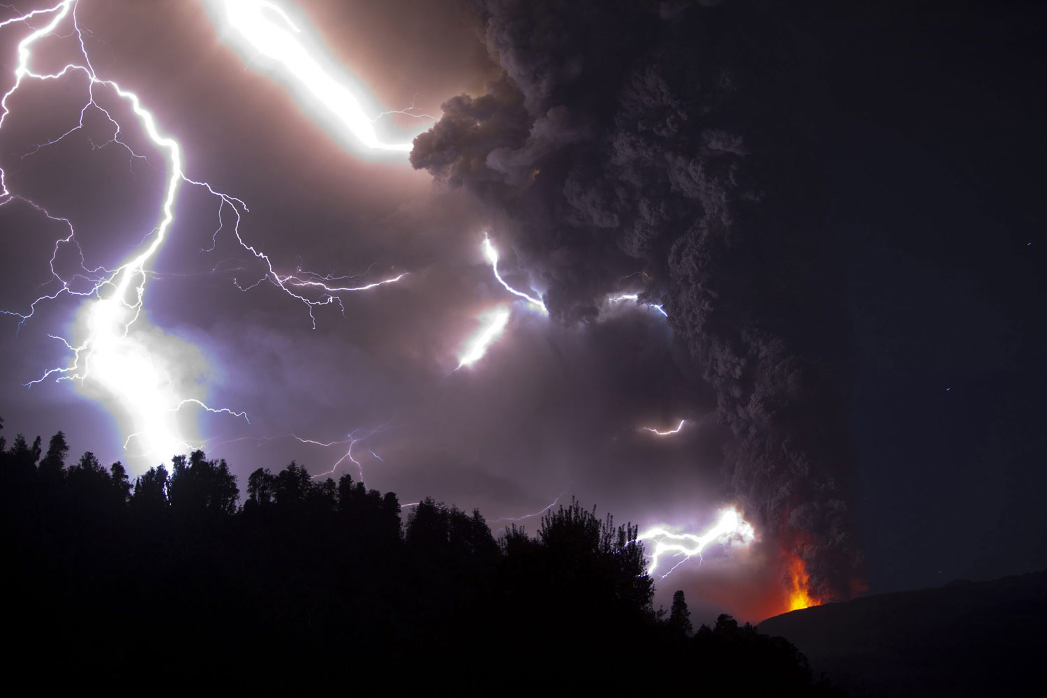 Ash billowing from Puyehue volcano as lightening strikes in southern Chile on June 5, 2011.