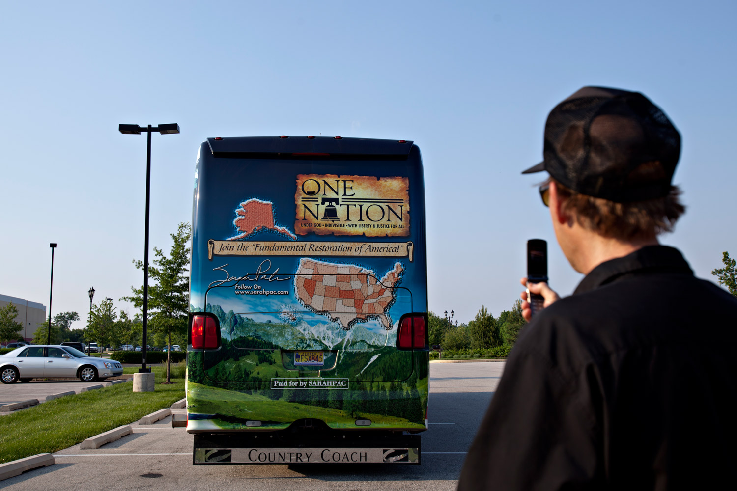 A man snaps a cell phone photograph of Sarah Palin's bus at a hotel in Gettysburg, PA, Monday, May 30, 2011.