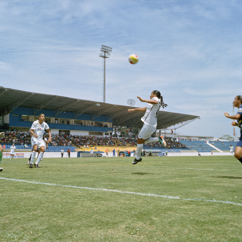 Santos player, Fran, heads the ball towards the opposing team's goal during a Campeonato Paulista de Futebol Feminino tournament match in São José dos Campos, Brazil. (November 20, 2010)