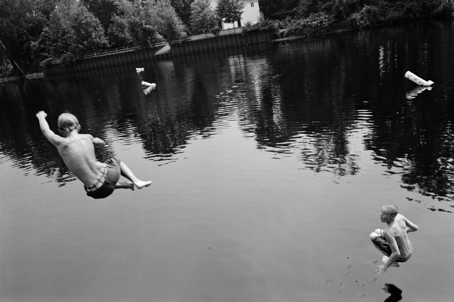 Young men jump into the river in Fort Edward, New York. This area is the site of the discharge of polychlorinated biphenyls into the river by the General Electric plant located immediately upriver, and has been undergoing dredging to remove the PCB's, as mandated by Superfund legislation and the suit brought against GE. 2010.