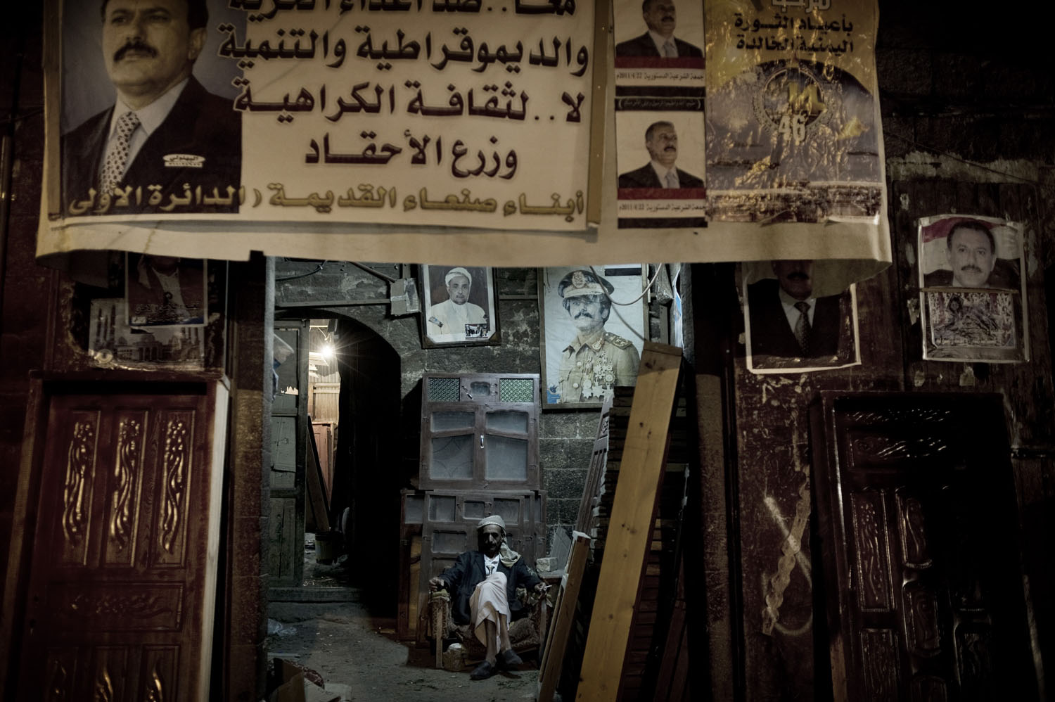 A shop with the posters of Yemen's President Ali Abdullah Saleh at the old town in Sana'a, May 12, 2011.