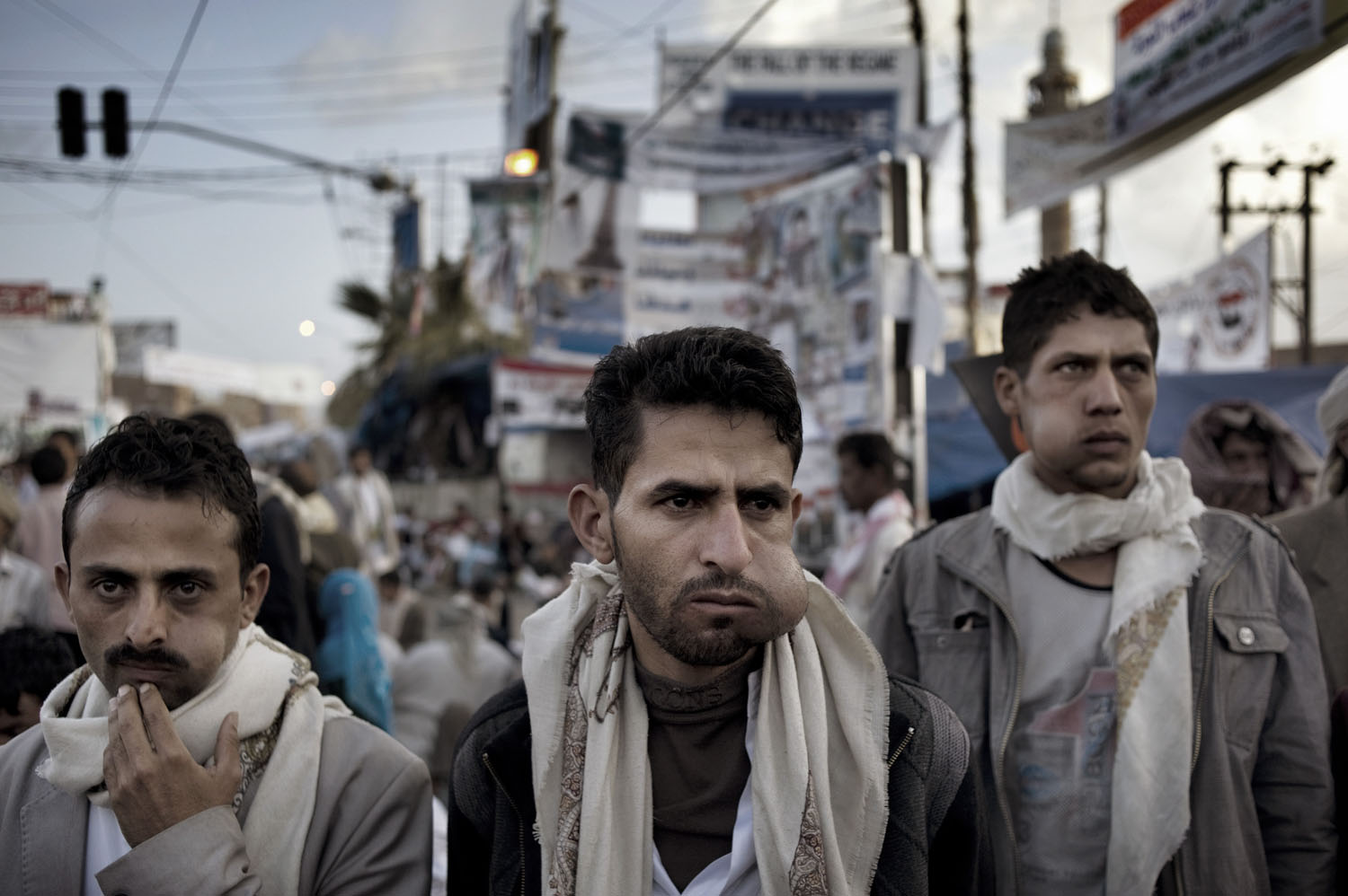 Anti-government protesters, their cheeks bulging with khat, at Change Square near the university in Sana'a, May 13, 2011.
