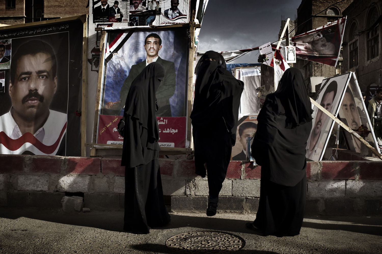 Yemeni women visit the shrine of deceased protesters in a tent city outside of the university, May 17, 2011.