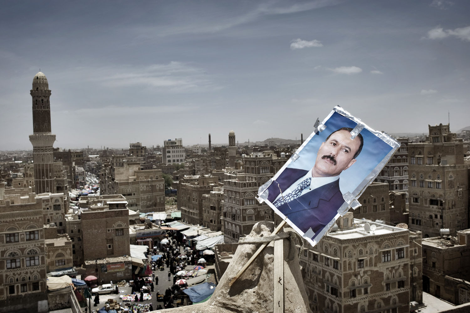 A poster of Yemen's President Ali Abdullah Saleh is seen at the roof of a house at the old town of Sana'a, May 18, 2011.