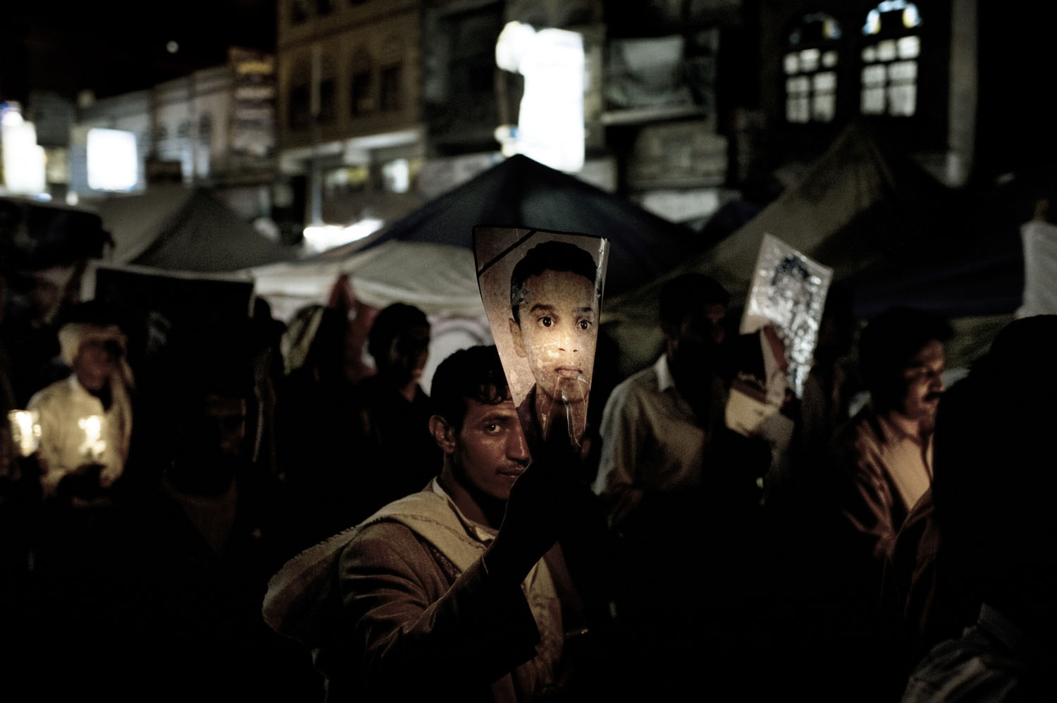 A candle lit march with the portraits of deceased protesters, May 18, 2011.