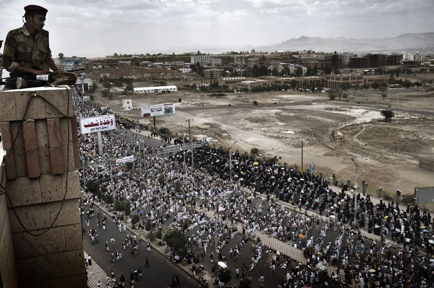 A defected soldier watches anti-government rally in Sana'a, demanding the ousting of Yemen's President Ali Abdullah Saleh, May 20, 2011.