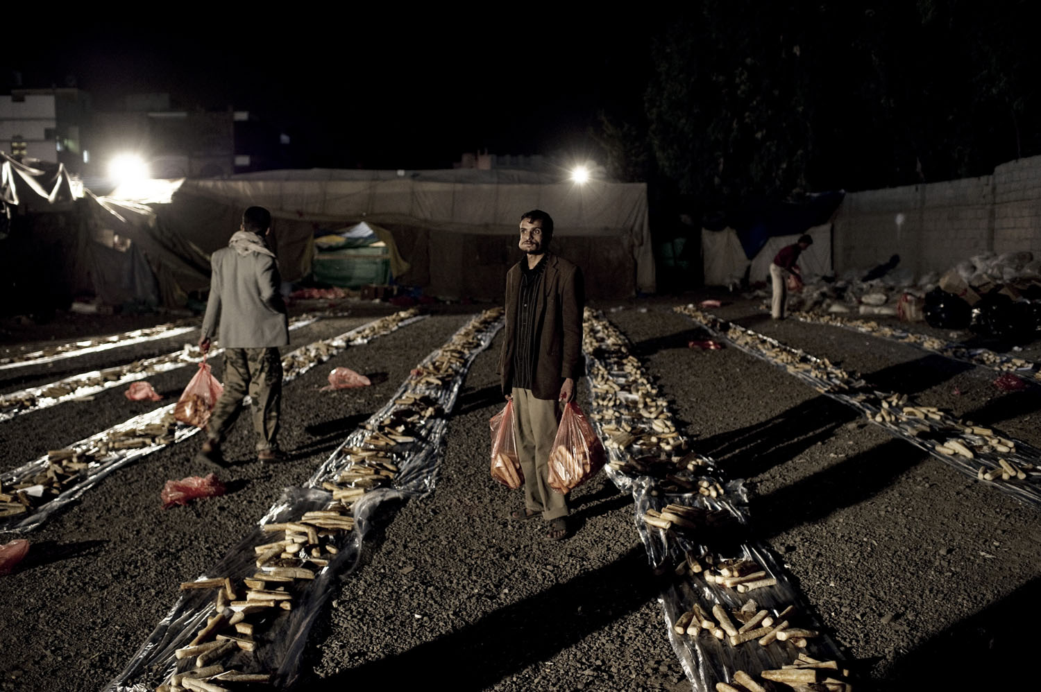 Protesters receive food in Sana'a, May 20, 2011.