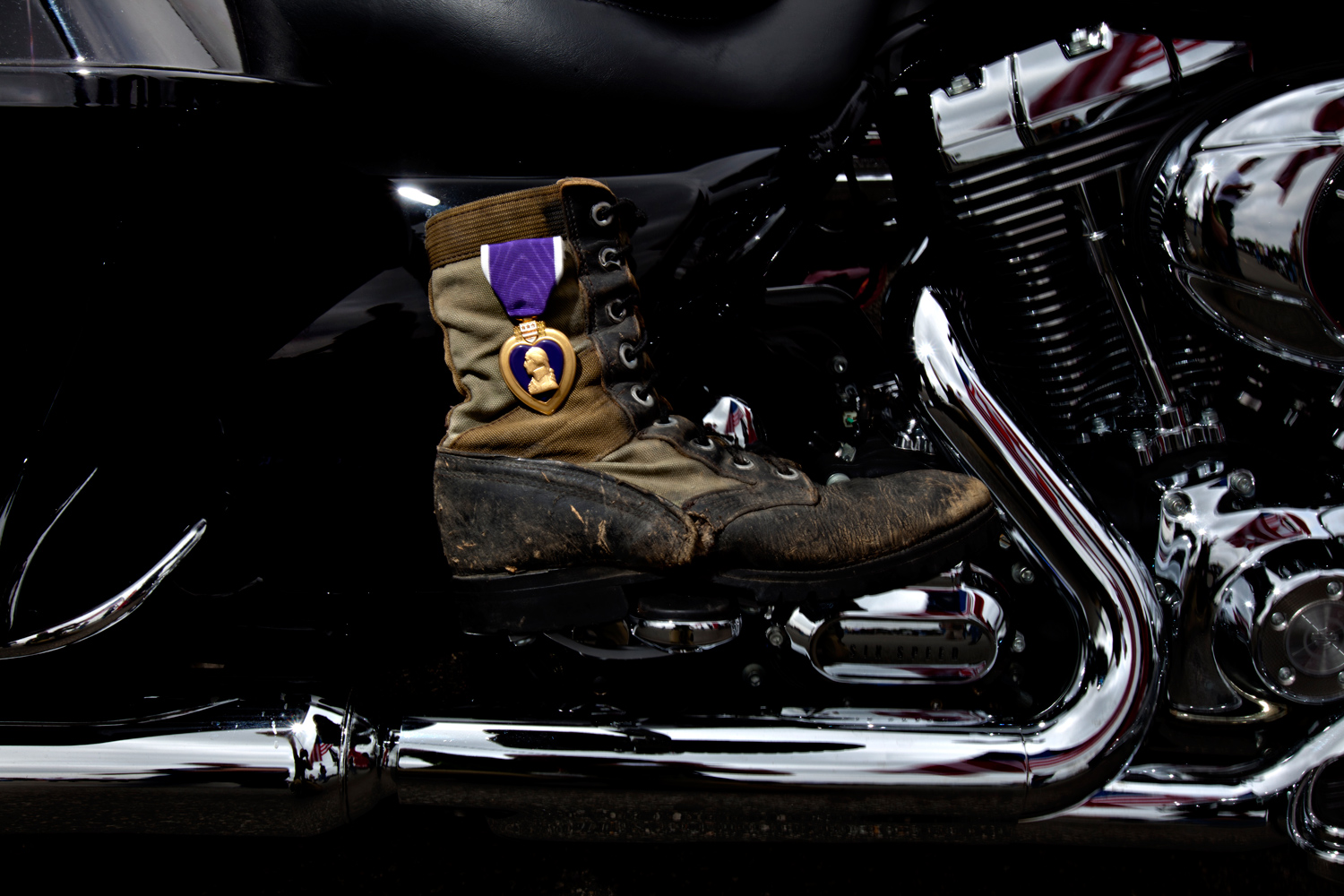 A purple heart pinned to a bikers boot at the start of the Rolling Thunder rally  Washington, DC. Sunday, May 29, 2011.