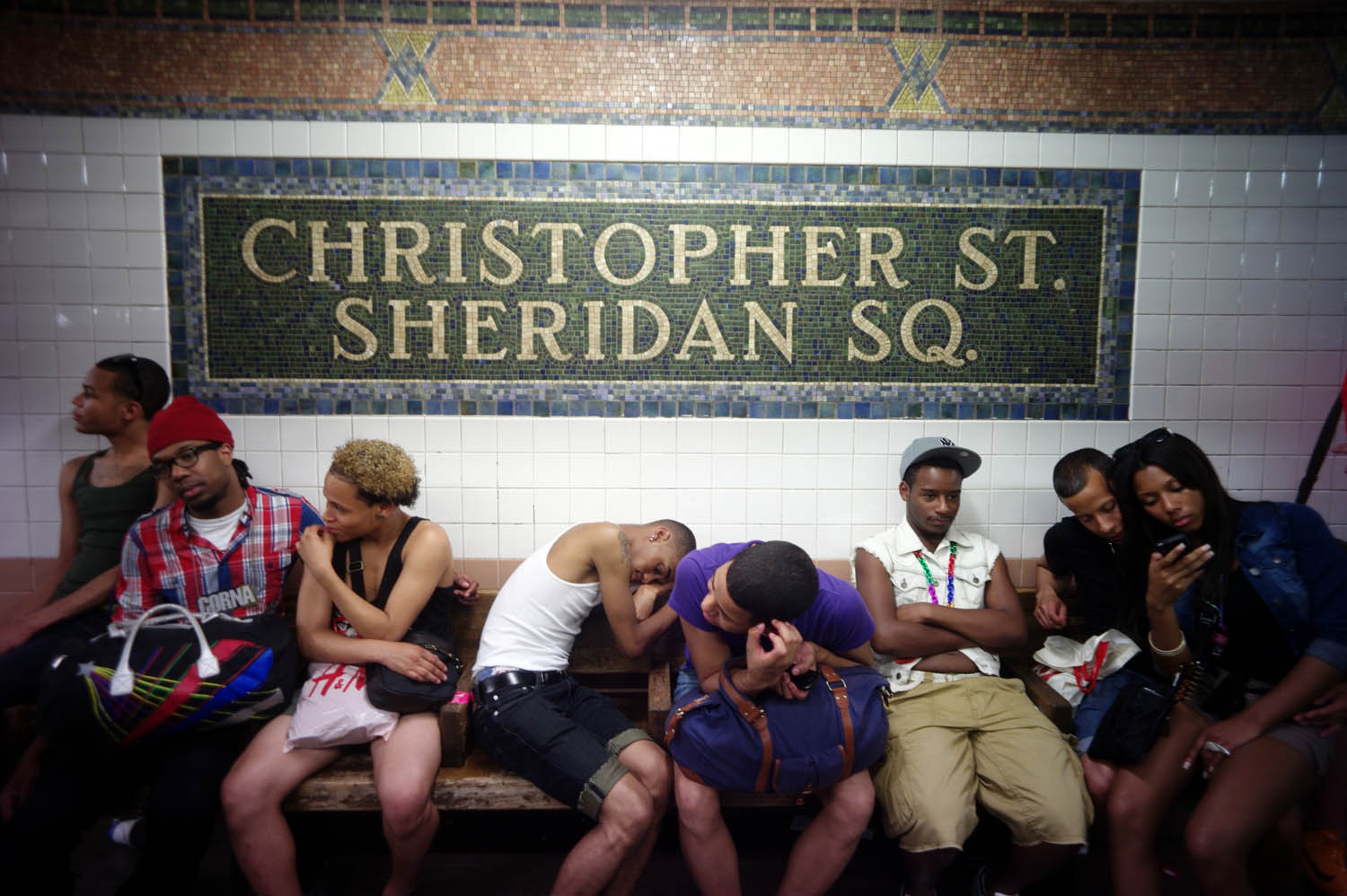 Parade-goers wait for a train home, June 26, 2011.