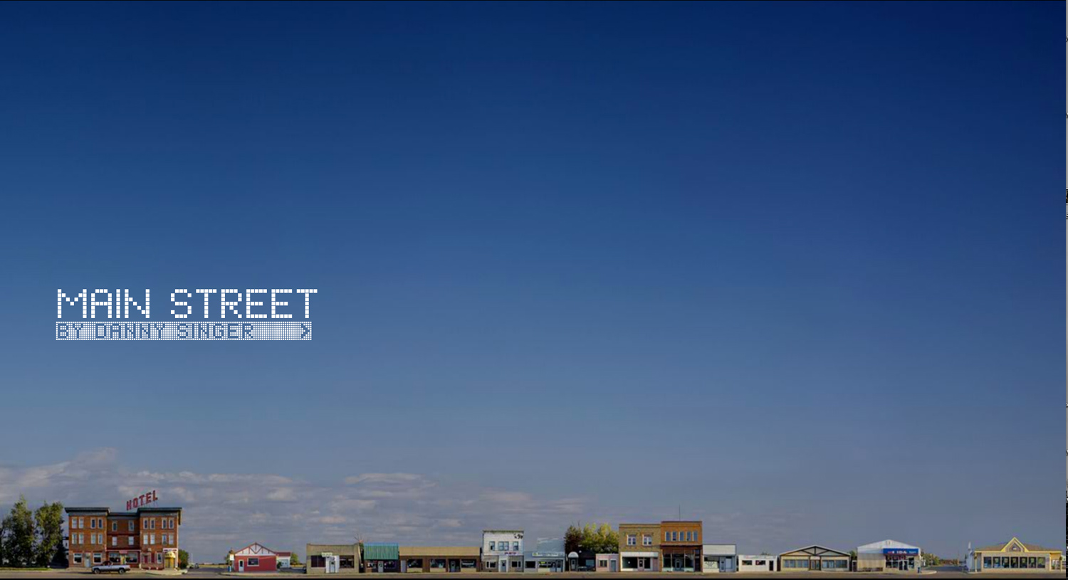 A screen capture from Main Street by Danny Singer. This site walks visitors through a giant panoramic photograph of the town.