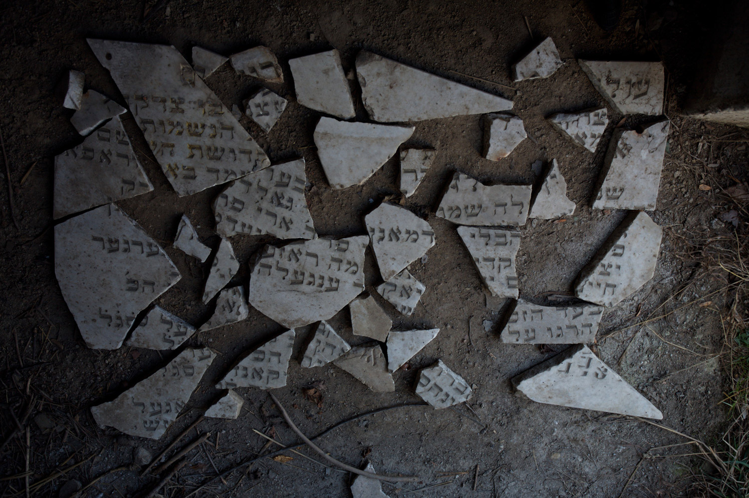 A broken tombstone of a famous Rabbi at the cemetery in Huncovce