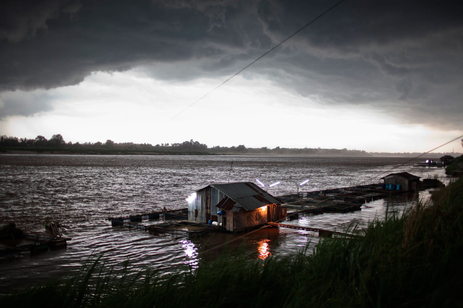 An afternoon storm approaches a fish farm on the Mekong River in Vientiane, Laos People's Democratic Republic on May 12, 2011.