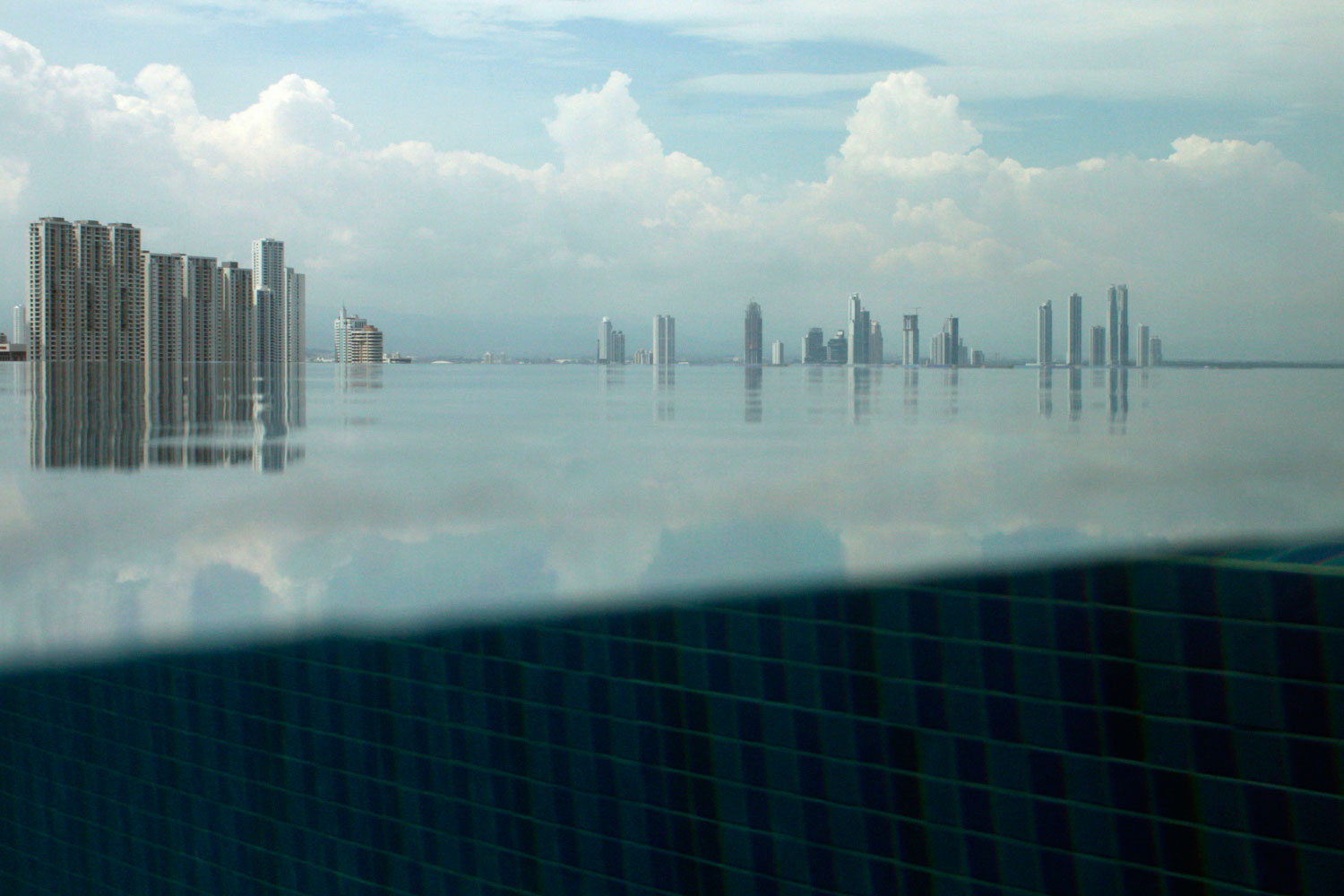 July 6, 2011. The Panama City skyline is reflected in a swimming pool at the Trump Ocean Club International Hotel and Tower.