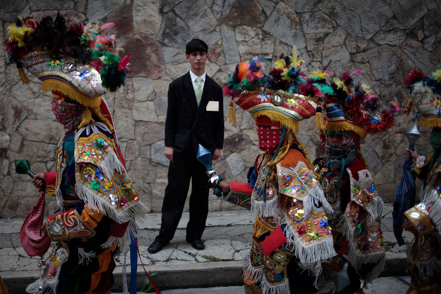 July3, 2011. A man watches a traditional dance during the Corpus Christi procession in the streets of Guatemala City.