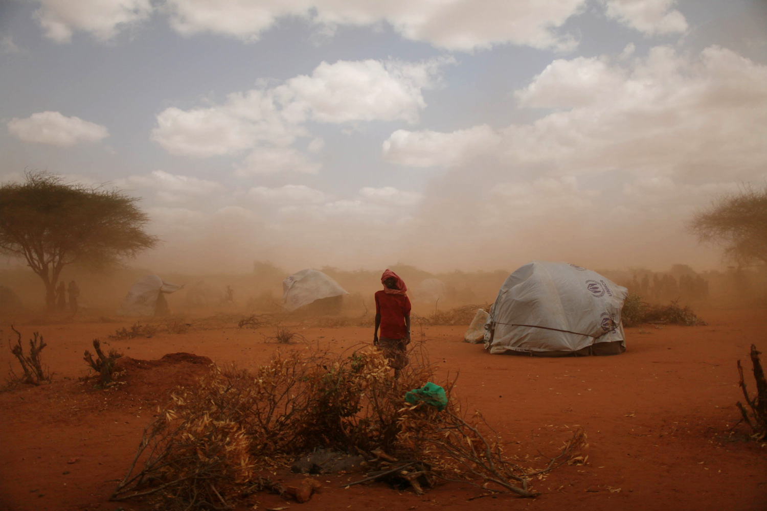 A sandstorm blows through Ifo Camp where new arrivals live. 30,000 people are estimated to have arrived at the camp in June, a steep climb from the average of 5,000 last year. Dadaab, Eastern Kenya, July 18, 2011.