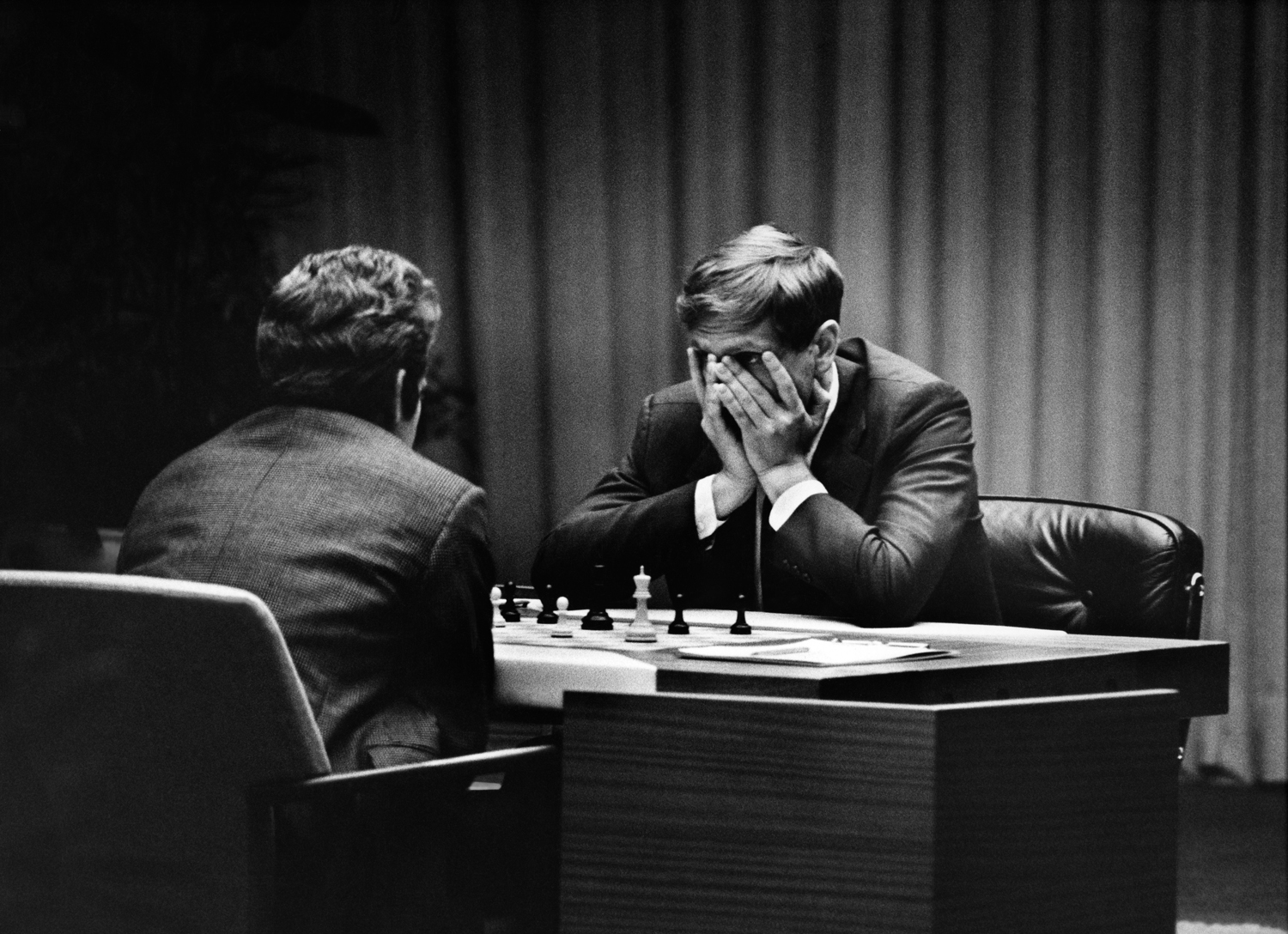 Fischer peers out of his hands during a game with Spassky at their World Championship match, Iceland, 1972
