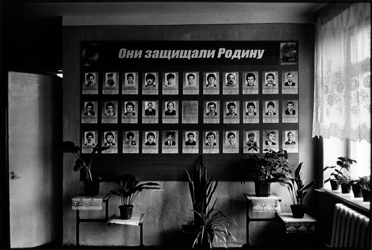 Portraits of the soldiers who were born in the village and died in the war Transnistria fought in support of its independence. The slogan reads,  They defended the Motherland.