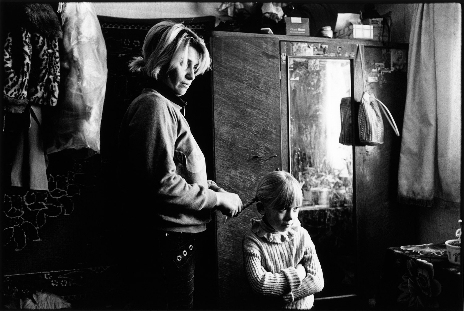 A mother and daughter in their home in Lenina, a village in Transnistria, an unrecognized state between Romania and Ukraine. Photographer Kosuke Okahara visited the region in 2010, in order to explore what life is like  in a country that doesn't exist,  to learn  if the people are still very attached to the place where they live.