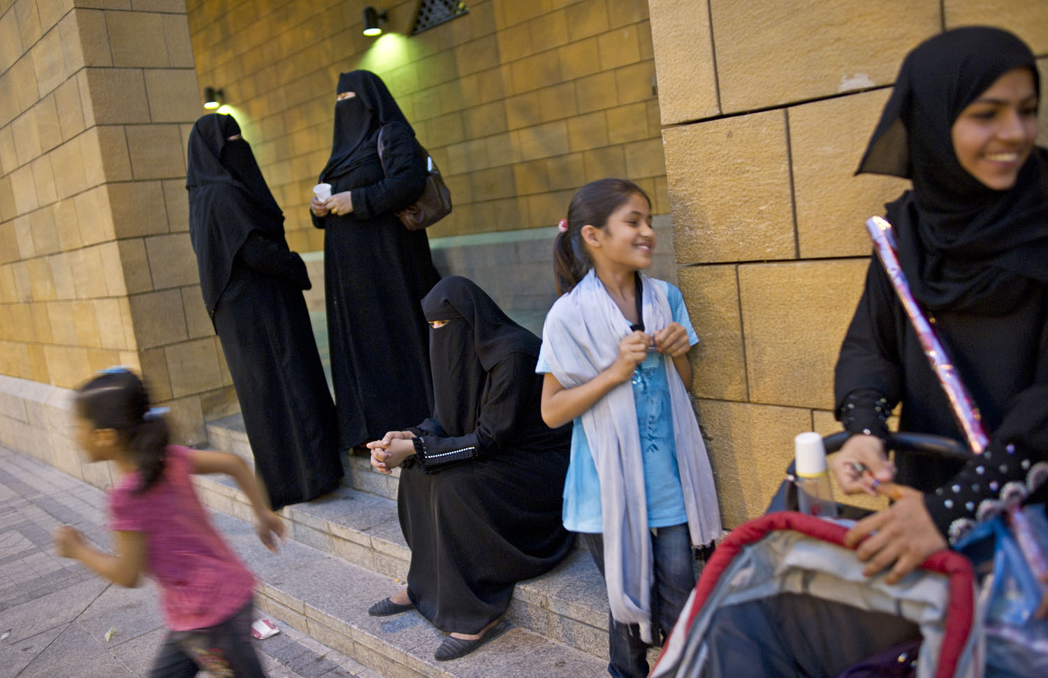 Saudi women sit outside of the mosque during evening prayer in Diera, in Riyadh, Saudi Arabia, June 10, 2011. Saudi Arabia is governed by Sharia Law, which is law according to Islam, and thus there are many cultural restrictions which segregate men and women throughout society; all businesses must close for the five prayer times per day in Saudi.