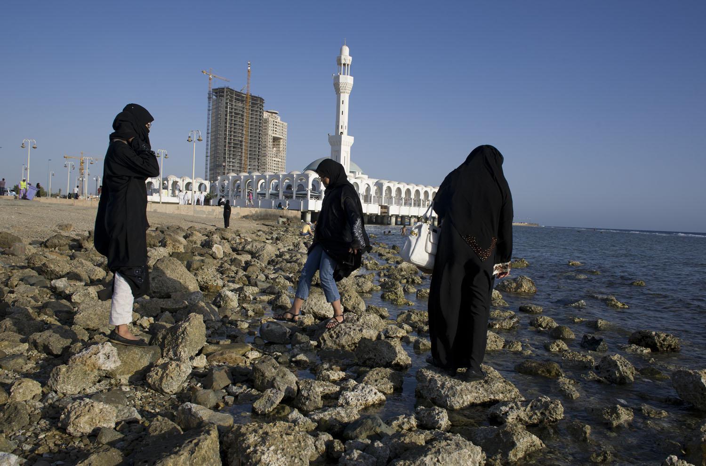 Saudi women walk along the corniche in Jeddah, Saudi Arabia, June 15, 2011.