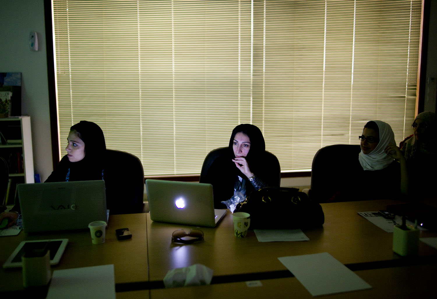 Riam Darwish checks notes on her computer during a presentation in Ahmed el Shukairy's office, in Jeddah, Saudi Arabia, June 16, 2011.  Shukairy, often compared to the Oprah of Saudi, has a very popular television show during Ramadan. In this meeting at his office, he is running previews by his 'dream team' to get their feedback.