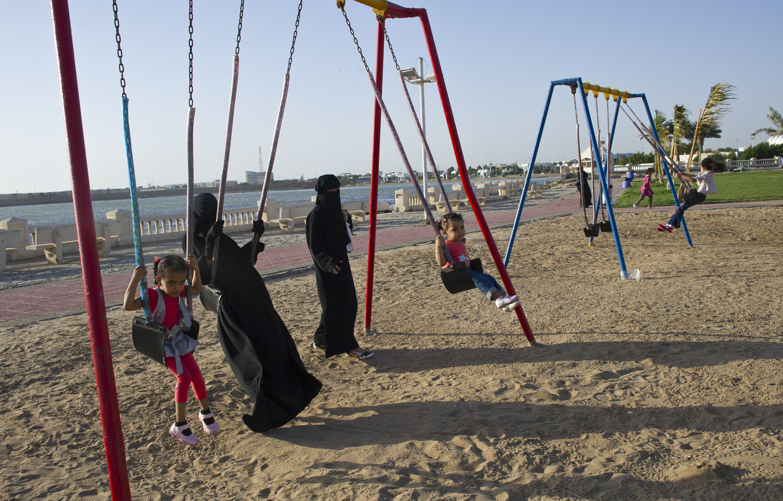 Saudi women play at a playground along the corniche in Jeddah, Saudi Arabia, June 14, 2011.