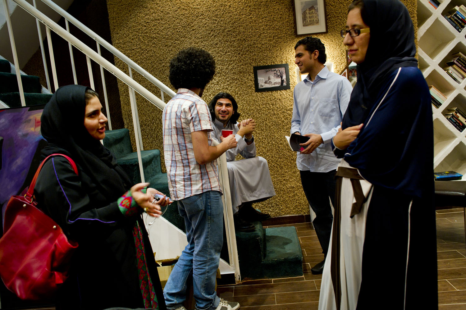 Young Saudis gather in Bridges bookstore—one of the few bookstores in the country, in Jeddah, Saudi Arabia, June 14, 2011. While bookstores like this are common throughout most of the rest of the world, they are extremely rare in Saudi Arabia, and provide young people with a place to study, have philosophical and intellectual discussions, and to meet for book clubs in Jeddah.