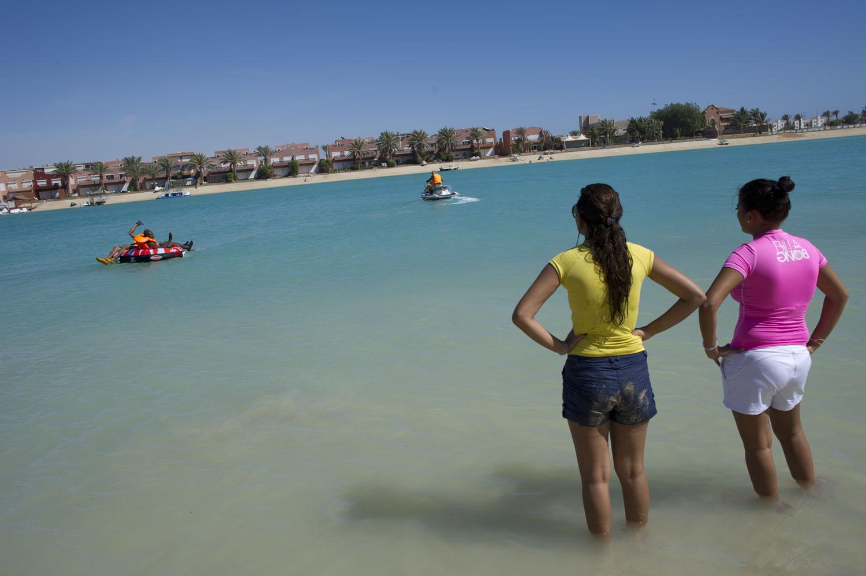 Young Saudis swim and jet ski at Durrat al Aruz, outside of Jeddah, Saudi Arabia, June 15, 2011.