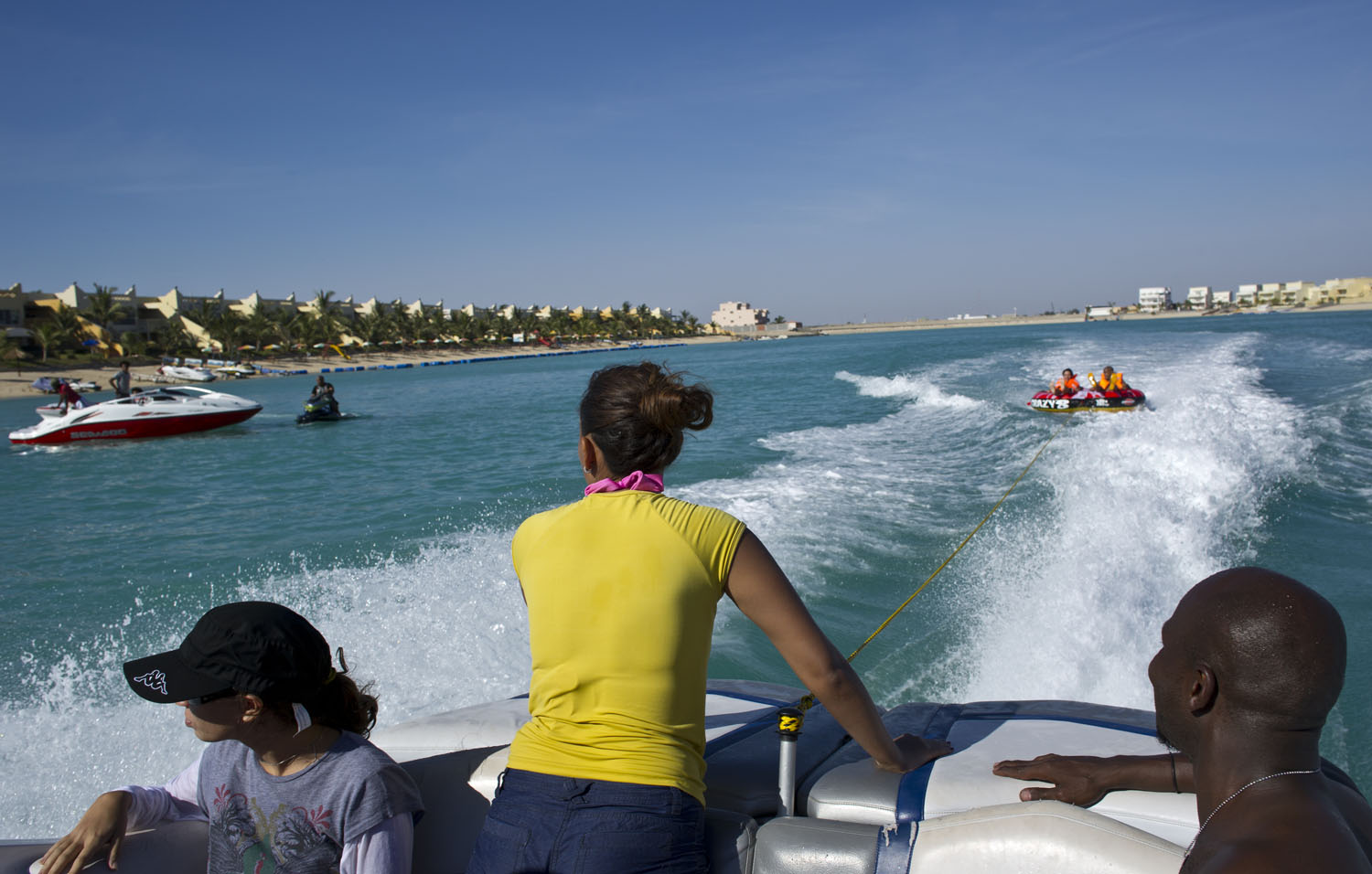Young Saudis swim and jet ski at Durrat al Aruz, outside of Jeddah, Saudi Arabia, June 15, 2011. The beaches around Jeddah are some of the few places where Saudi's religious police do not have a presence, and young men and women are able to swim and hang out freely.