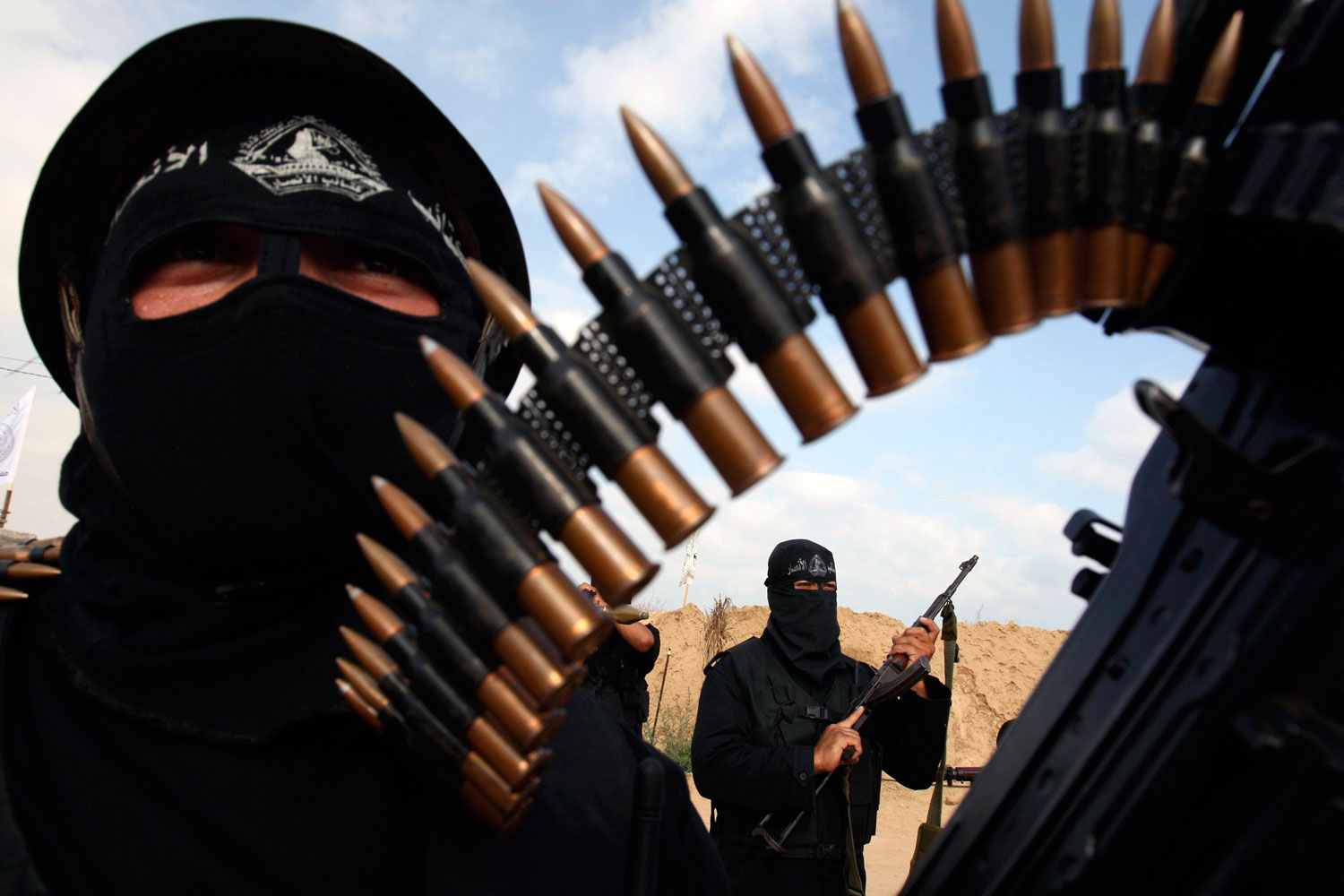 July 7, 2011. Palestinian militants from Al-Ansar brigades, the armed wing of Al-Ahrar movement, demonstrate their skills during a drill in front of the media in Khan Younis in the southern Gaza Strip July 7, 2011.