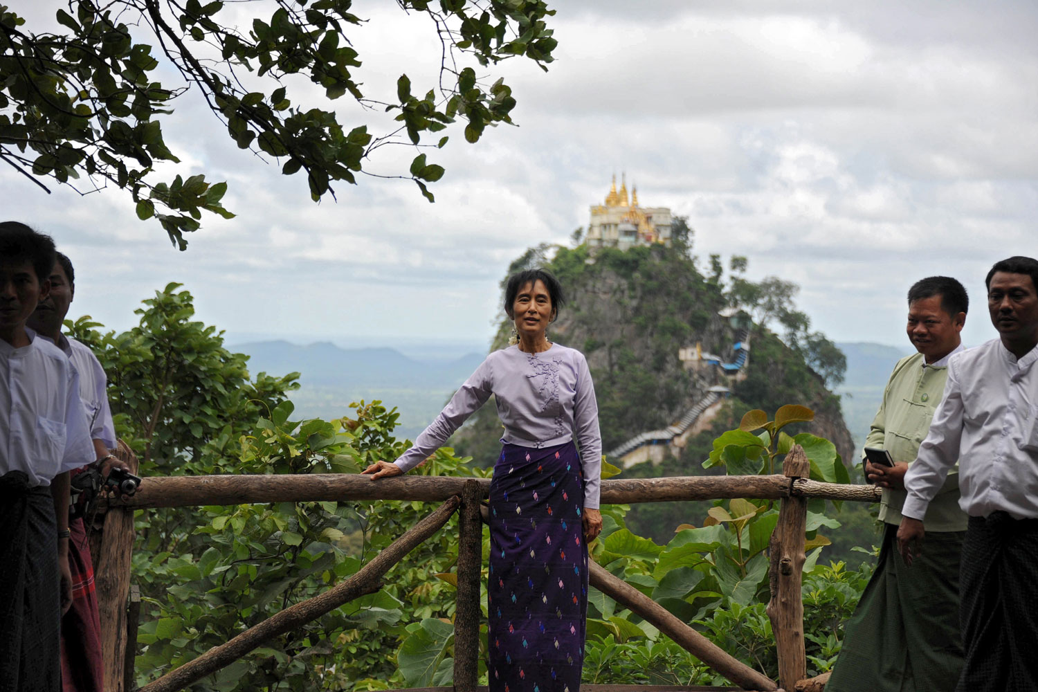 July 6, 2011. Democracy icon Aung San Suu Kyi poses for a photograph during her visit to Mt. Popa in Kyauk Padaung Township, near Mandalay. Suu Kyi attracted a large crowd as she continued her visit to an ancient temple city in central Myanmar, proving her enduring popularity after years of house arrest.